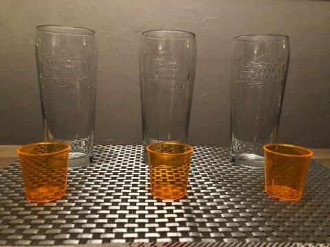 Three pint glasses and three shot glasses